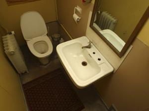 View Inside Bathroom with Sink and Toilet