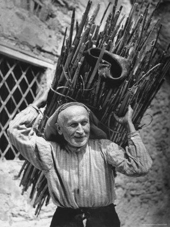 https://imgc.allpostersimages.com/img/posters/view-of-a-man-carrying-a-big-bundle-of-sticks-from-a-story-concerning-italy_u-L-P3OHC60.jpg?p=0