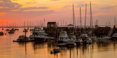 View of boats at a harbor during sunset, Rockland Harbor, Rockland, Knox County, Maine, USA