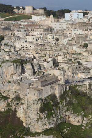 https://imgc.allpostersimages.com/img/posters/view-of-chiesa-di-san-pietro-caveoso-in-the-sassi-area-of-matera-and-the-ravine_u-L-PQ8RIN0.jpg?p=0