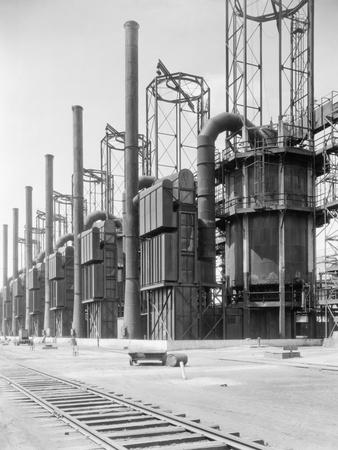 https://imgc.allpostersimages.com/img/posters/view-of-cracking-stills-at-oil-refinery_u-L-PZMO1N0.jpg?p=0