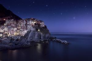 View of Manarola on a Starry Night, La Spezia, Liguria, Northern Italy
