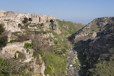 https://imgc.allpostersimages.com/img/posters/view-of-sant-agostino-convent-in-the-sassi-area-of-matera-and-ravine-basilicata-italy-europe_u-L-PQ8QZB0.jpg?p=0