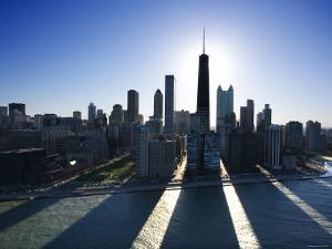 View of Skyscrapers and High-Rises with the Sun Behind the Sears Tower in Chicago, Illinois