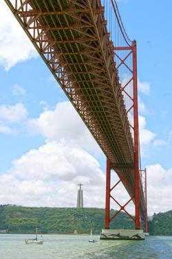 View of the 25 De Abril Bridge and Christ the King Statue from the North Bank of Tejo River