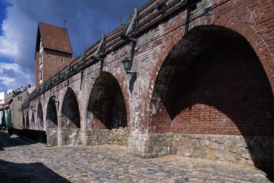 https://imgc.allpostersimages.com/img/posters/view-of-the-city-walls-historic-centre-of-riga_u-L-PPQKK20.jpg?p=0