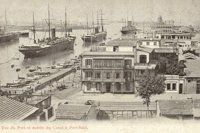 https://imgc.allpostersimages.com/img/posters/view-of-the-port-and-the-entrance-to-the-suez-canal-port-said-egypt_u-L-PRBXXA0.jpg?p=0