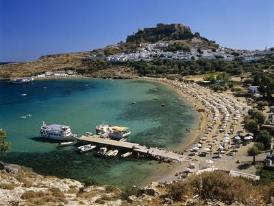 https://imgc.allpostersimages.com/img/posters/view-over-beach-and-castle-lindos-rhodes-island-dodecanese-islands-greek-islands-greece_u-L-PWFBF40.jpg?p=0
