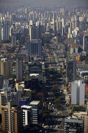 https://imgc.allpostersimages.com/img/posters/view-over-sao-paulo-skyscrapers-and-traffic-jam-from-taxi-helicopter_u-L-PXXTUH0.jpg?p=0
