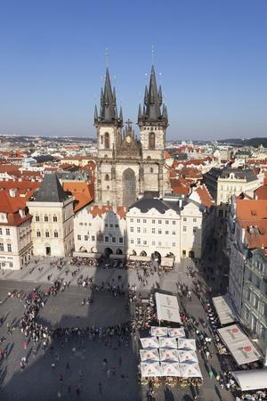 https://imgc.allpostersimages.com/img/posters/view-over-the-old-town-square-staromestske-namesti-with-tyn-cathedral-and-street-cafes_u-L-PQ8QGB0.jpg?p=0