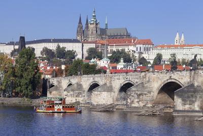 https://imgc.allpostersimages.com/img/posters/view-over-the-river-vltava-with-excursion-boat-to-charles-bridge-and-the-castle-district_u-L-PQ8PSZ0.jpg?p=0