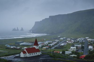 https://imgc.allpostersimages.com/img/posters/view-over-the-village-of-vik-on-a-rainy-day-iceland-polar-regions_u-L-PWFQU20.jpg?p=0