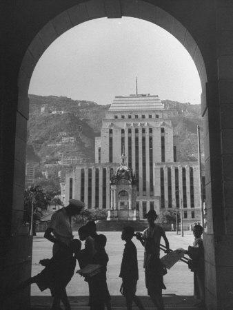 https://imgc.allpostersimages.com/img/posters/view-through-archway-toward-hong-kong-shanghai-bank_u-L-P7516K0.jpg?p=0