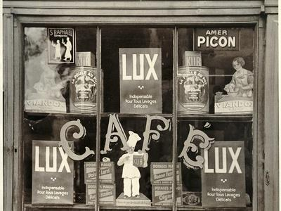 https://imgc.allpostersimages.com/img/posters/view-through-french-shop-window_u-L-PZOSSR0.jpg?artPerspective=n