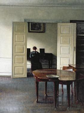 An Interior with a Woman Playing Piano, 1910 by Vilhelm Hammershoi