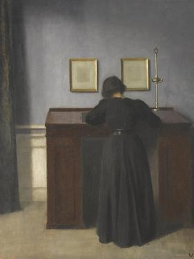 Ida Standing at a Desk by Vilhelm Hammershoi