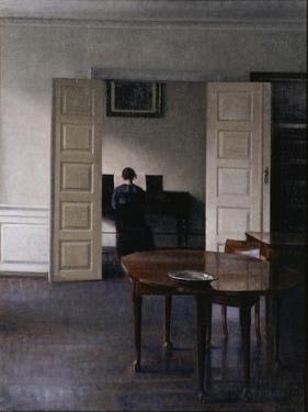 Interior with Ida Playing the Piano by Vilhelm Hammershoi