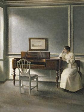 Woman Reading by a Piano, 1907 by Vilhelm Hammershoi