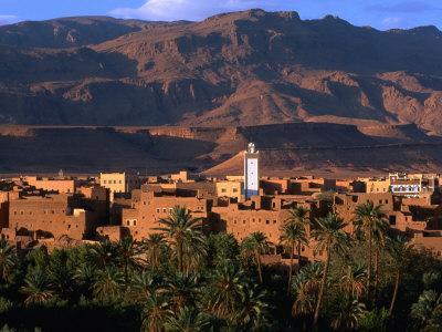 https://imgc.allpostersimages.com/img/posters/village-of-tinerhir-on-banks-of-river-todra-todra-gorge-morocco_u-L-P3SB4N0.jpg?p=0