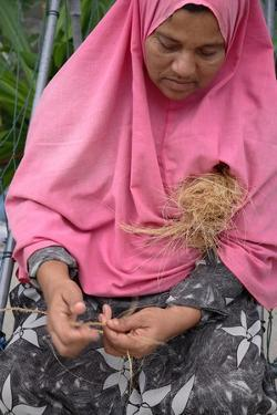 Village Woman Making Ropes in the Maldives