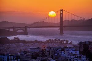 Setting Sun Behind Golden Gate Bridge, Downtown San Francisco by Vincent James