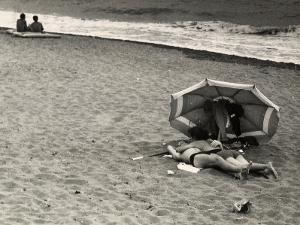 Young Couple, in an Amorous Embrace, Lying on the Beach on the Seashore by Vincenzo Balocchi