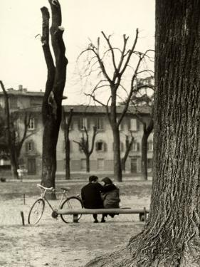 Young Couple Sitting on a Bench in Piazza Donatello in Florence by Vincenzo Balocchi