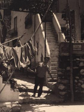Young Man with Basket on San Francesco Street in Capri by Vincenzo Balocchi