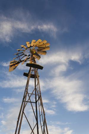 https://imgc.allpostersimages.com/img/posters/vintage-farm-windmills-at-sunset-elk-city-oklahoma-usa_u-L-PN6VLP0.jpg?artPerspective=n