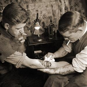 Vintage Shot of a Man Being Tattooed
