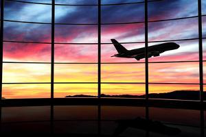 Airport Window with Airplane Flying at Sunset by viperagp