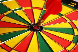 Dart in Center of a Dartboard by Visage