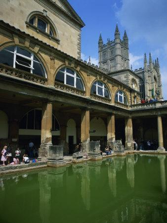 https://imgc.allpostersimages.com/img/posters/visitors-in-the-roman-baths-with-the-abbey-beyond-in-bath-avon-england-uk_u-L-P7XJJG0.jpg?p=0