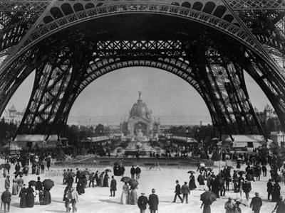 Visitors Strolling Around the Eiffel Tower