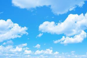 Blue Sky Background with a Tiny Clouds by Vitaliy Pakhnyushchyy