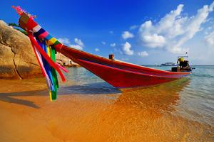 Traditional Thai Longtail Boat on the Beach by vitalytitov