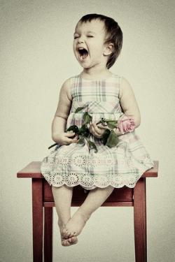 Vintage Portrait of Crying Little Girl with Rose by vitalytitov