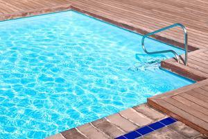 Wooden Floor beside the Blue Swimming Pool by vitalytitov