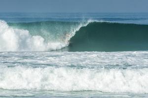 Surfing inside the Barrel in Barra Da Tijuca Beach, Rio De Janeiro, Brazil by Vitor Marigo