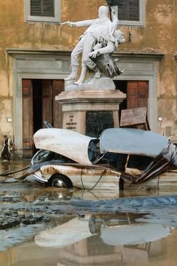 Wrecked Car Near Statue by Vittoriano Rastelli