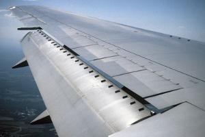 View of a Passenger Plane's Wing from Inside the Cabin by Vlad Kharitonov