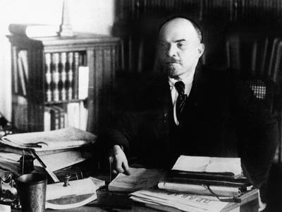 https://imgc.allpostersimages.com/img/posters/vladimir-lenin-at-his-desk-between-1920-to-1922_u-L-Q10WO980.jpg?artPerspective=n