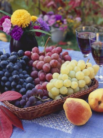 Basket of Grapes with Pears in Foreground