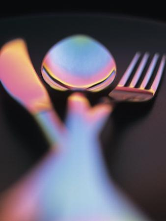 Knife, Fork and Spoon in Red and Blue Light