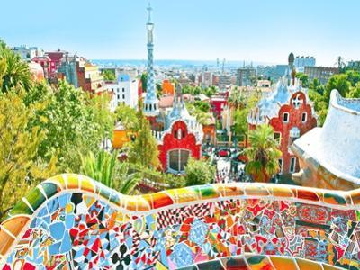 The Famous Summer Park Guell Over Bright Blue Sky In Barcelona, Spain by Vladitto