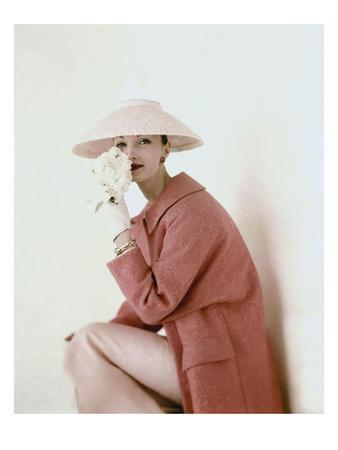 https://imgc.allpostersimages.com/img/posters/vogue-march-1956-model-evelyn-tripp-wearing-pink-ensemble_u-L-PFHHQW0.jpg?artPerspective=n