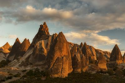 https://imgc.allpostersimages.com/img/posters/volcanic-desert-landscape-and-its-fabulous-geographical-structures-caught-in-evening-light_u-L-PWFIFN0.jpg?p=0
