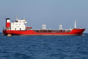 Red Tanker Designed for Transporting Crude Oil is at Anchor near the Port by Volina