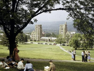 Students Sit on a Hill Overlooking the Dormitory at Cornell