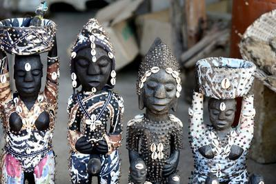 https://imgc.allpostersimages.com/img/posters/voodoo-statues-on-the-akodessawa-fetish-market-the-world-s-largest-voodoo-market-lome-togo_u-L-Q1GYJLJ0.jpg?artPerspective=n